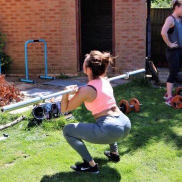 Lauren doing squats in her garden